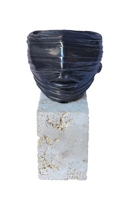 Living room sculpture by Igor Mitoraj titled Face